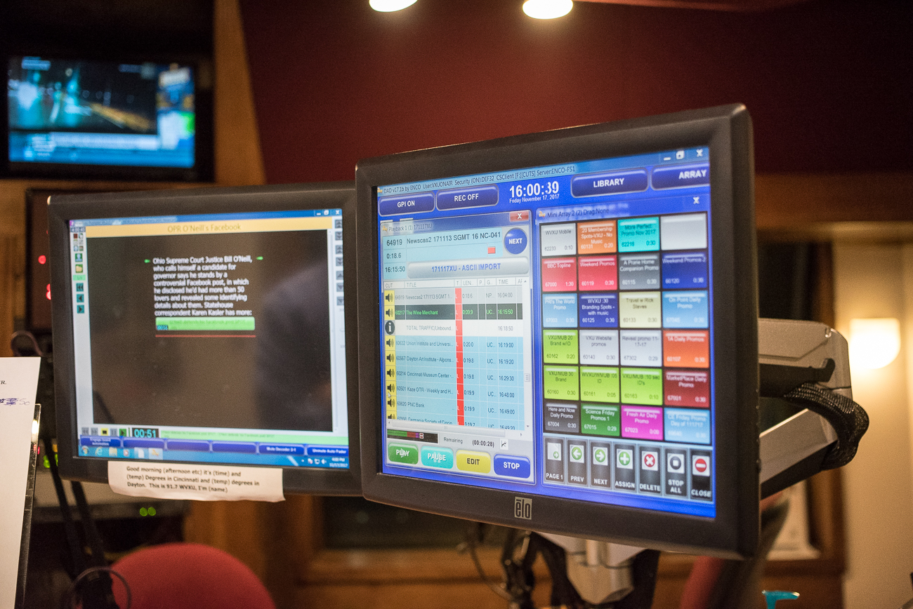 WVXU broadcasters utilize several monitors of information and controls while they read the news. / Image: Phil Armstrong, Cincinnati Refined // Published: 12.12.17