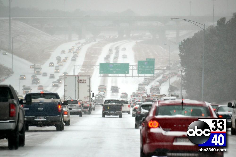 Traffic moves slowly on Interstate 459 near Hoover, Ala. during a winter storm, Tuesday, January 28, 2014.