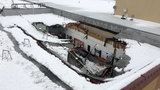 Heavy snow caves in roof at Verizon store in Lacey