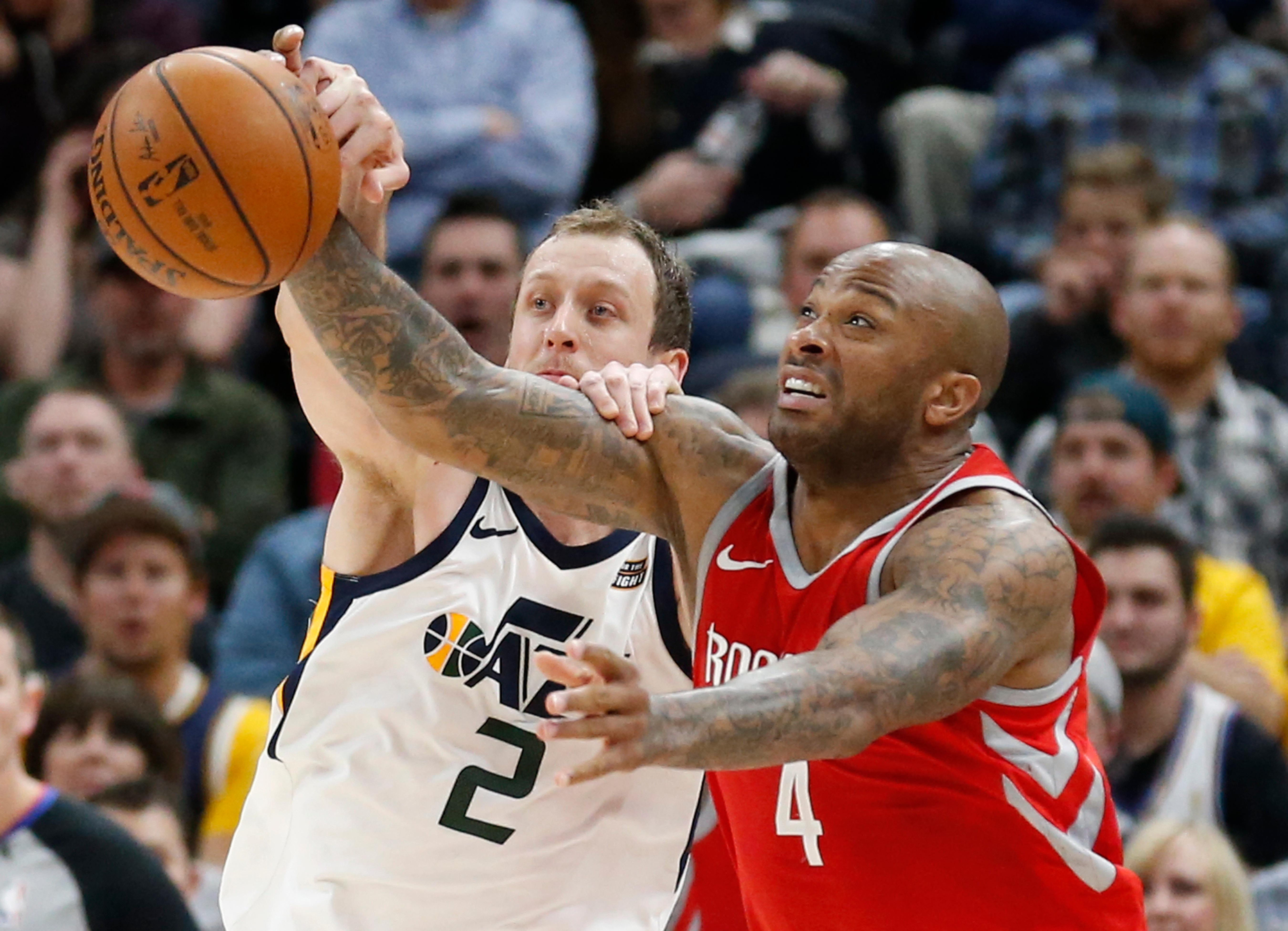 Utah Jazz forward Joe Ingles (2) and Houston Rockets forward PJ Tucker (4) battle for the ball in the second half during an NBA basketball game Monday, Feb. 26, 2018, in Salt Lake City. (AP Photo/Rick Bowmer)