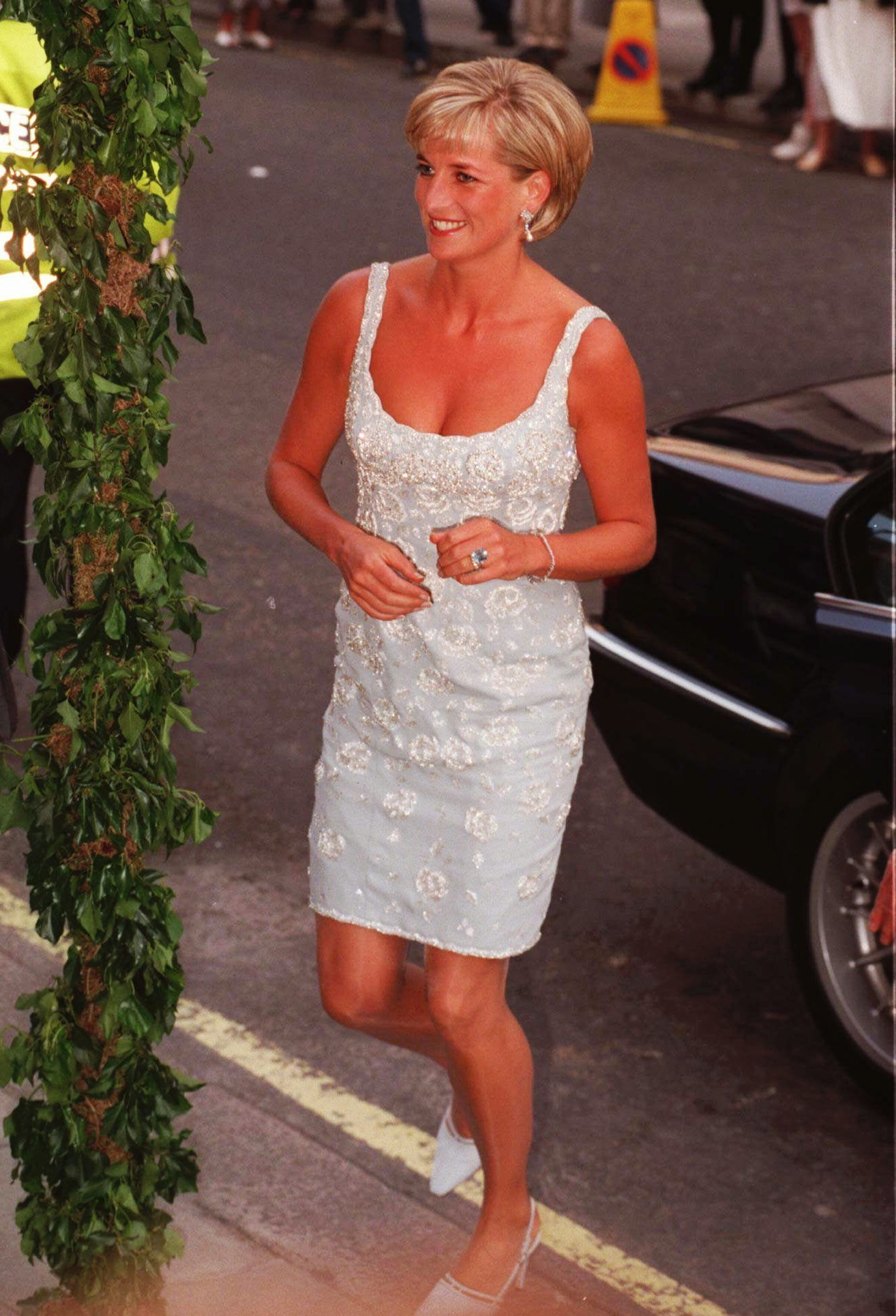 "FILE- In this Monday, June 2, 1997 file photo, Britain's Diana, Princess of Wales, arrives at Christie's Auction house in London to attend a private viewing and reception in aid of AIDS Crisis Trust and The Royal Marsden Hospital Cancer Fund. It has been 20 years since the death of Princess Diana in a car crash in Paris and the outpouring of grief that followed the death of the ""people's princess."" (AP Photo/Jacqueline Arzt, File)"
