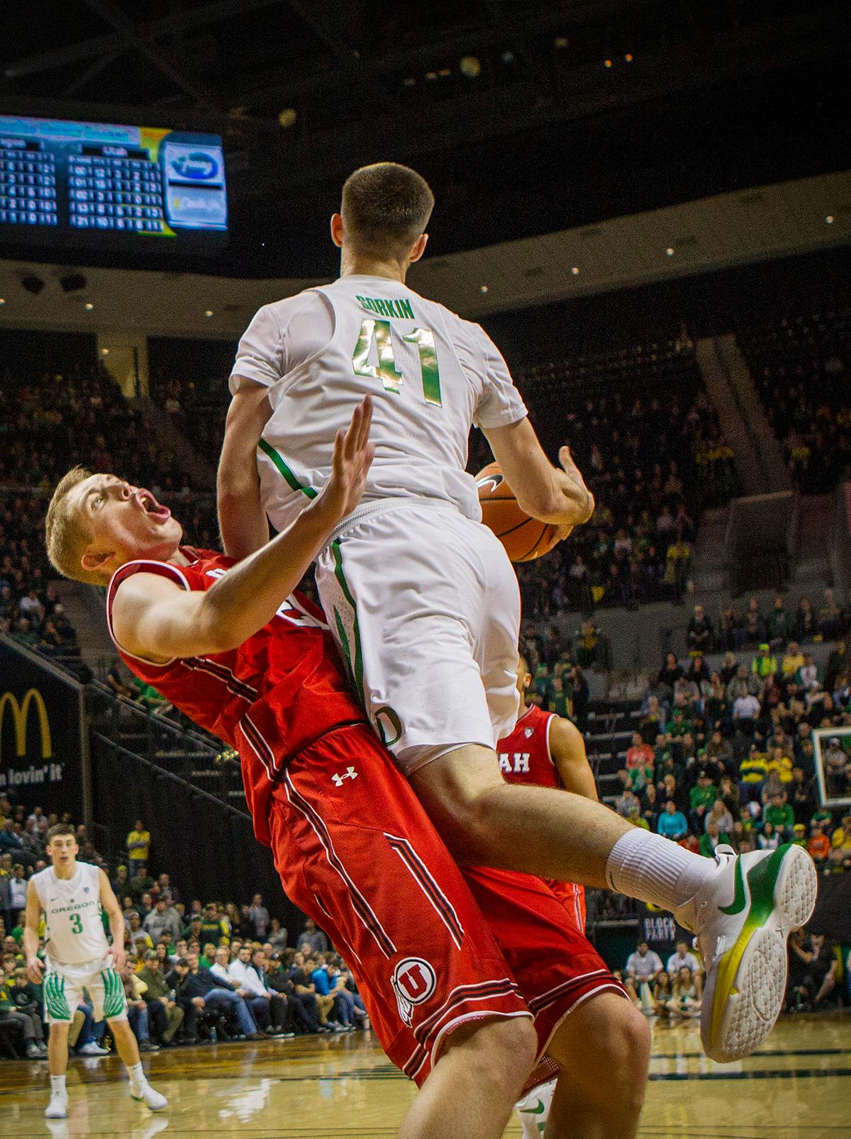 Oregon Ducks Roman Sorkin (#41) attempts to get past Utah's defense but Utah earns the charge on this play. The Utah Utes defeated the Oregon Ducks 66-56 on Friday night at Matthew Knight Arena. This is the first Pac-12 conference game loss at home for the Ducks since January of 2015. This also ended the five home game winning streak for the Ducks against the Utah Utes. Photo by Rhianna Gelhart, Oregon News Lab