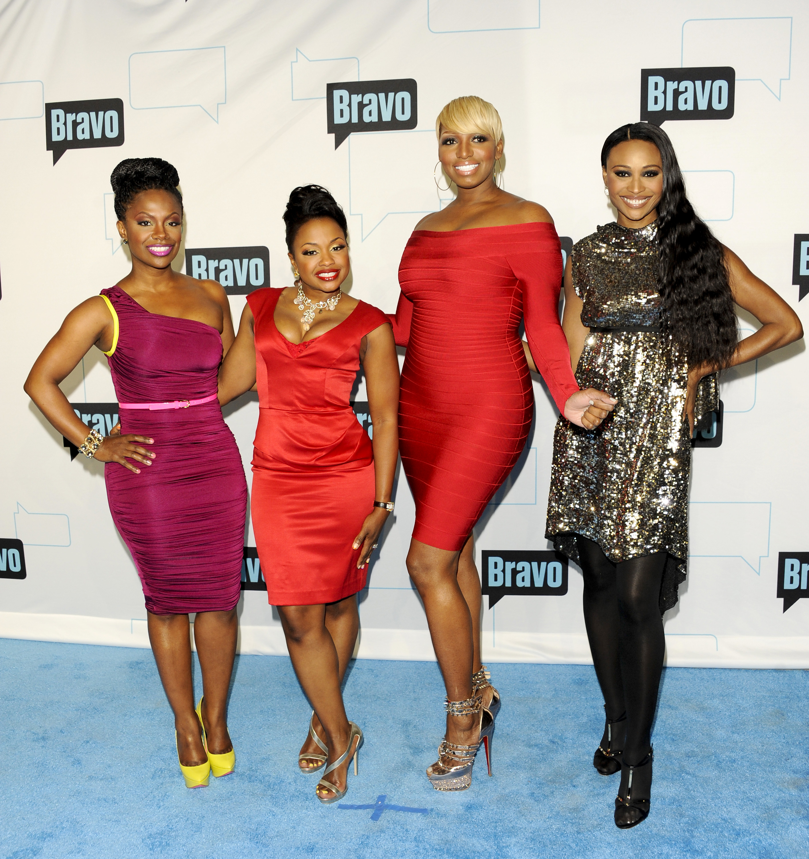 "Cast members from ""The Real Housewives of Atlanta"", from left, Kandi Burruss, Phaedra Parks, NeNe Leakes and Cynthia Bailey attend the Bravo network 2012 upfront presentation on Wednesday, April 4, 2012 in New York. (AP Photo/Evan Agostini)"