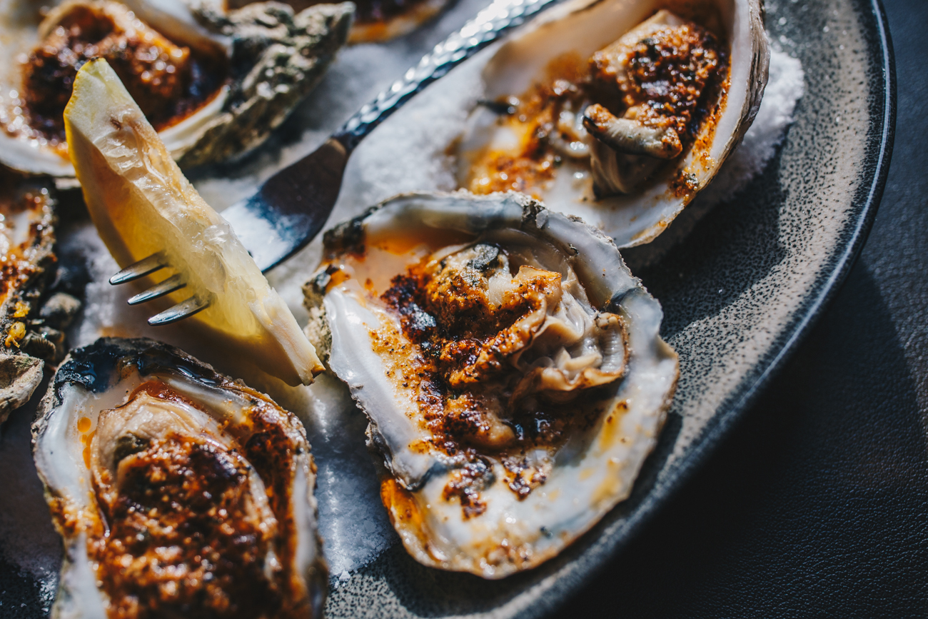 Charbroiled oysters: fresh shucked East Coast oysters broiled and topped with Creole garlic butter / Image: Catherine Viox // Published: 1.14.19