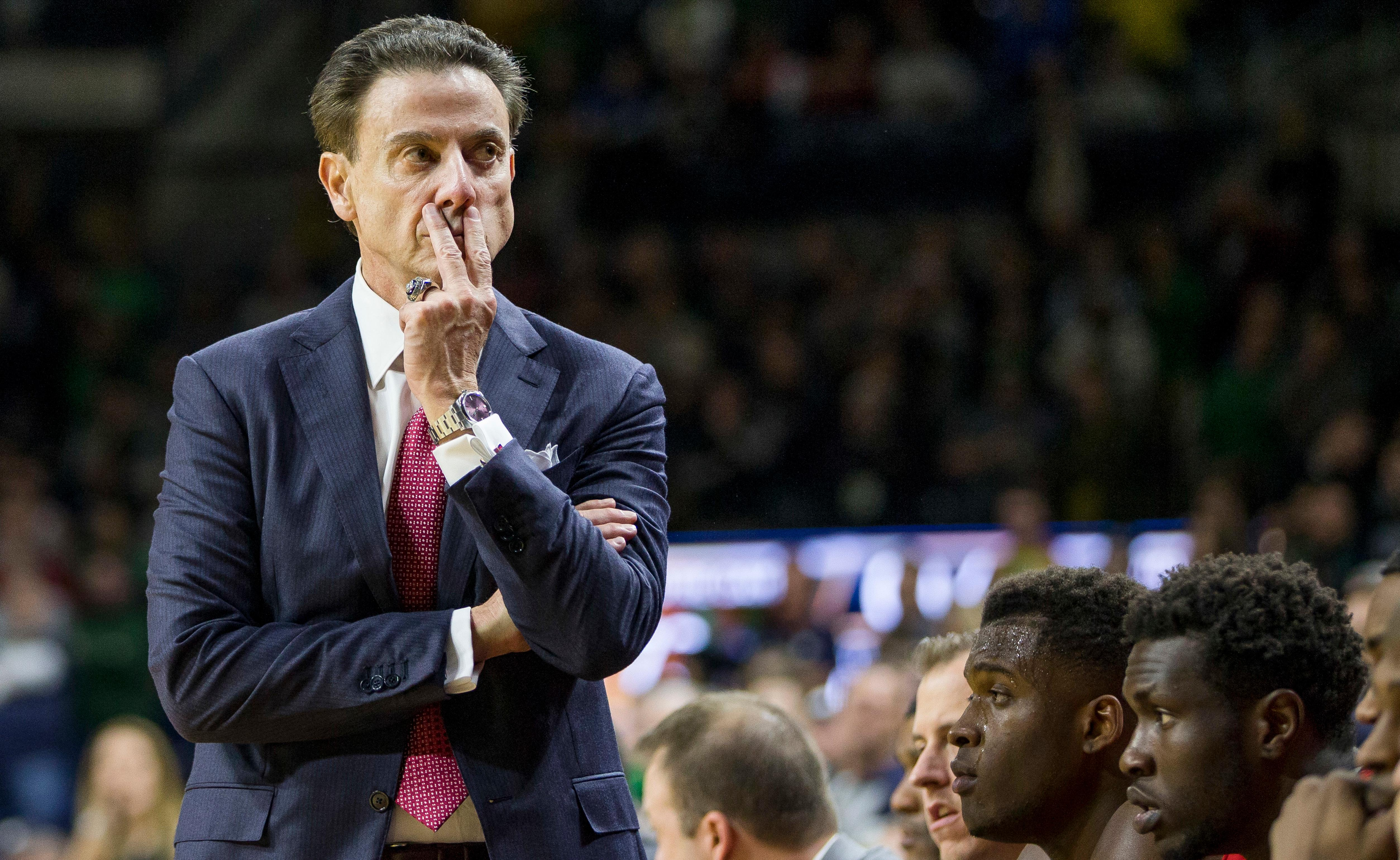FILE - In this Jan. 4, 2017, file photo, Louisville head coach Rick Pitino looks on as his team falls behind late in the second half of an NCAA college basketball game against Notre Dame in South Bend, Ind. The NCAA suspended Pitino, Thursday, June 15, 2017, for five ACC games following sex scandal investigation. A former men's basketball staffer is alleged to have hired strippers to entertain players and recruits.   (AP Photo/Robert Franklin, File)