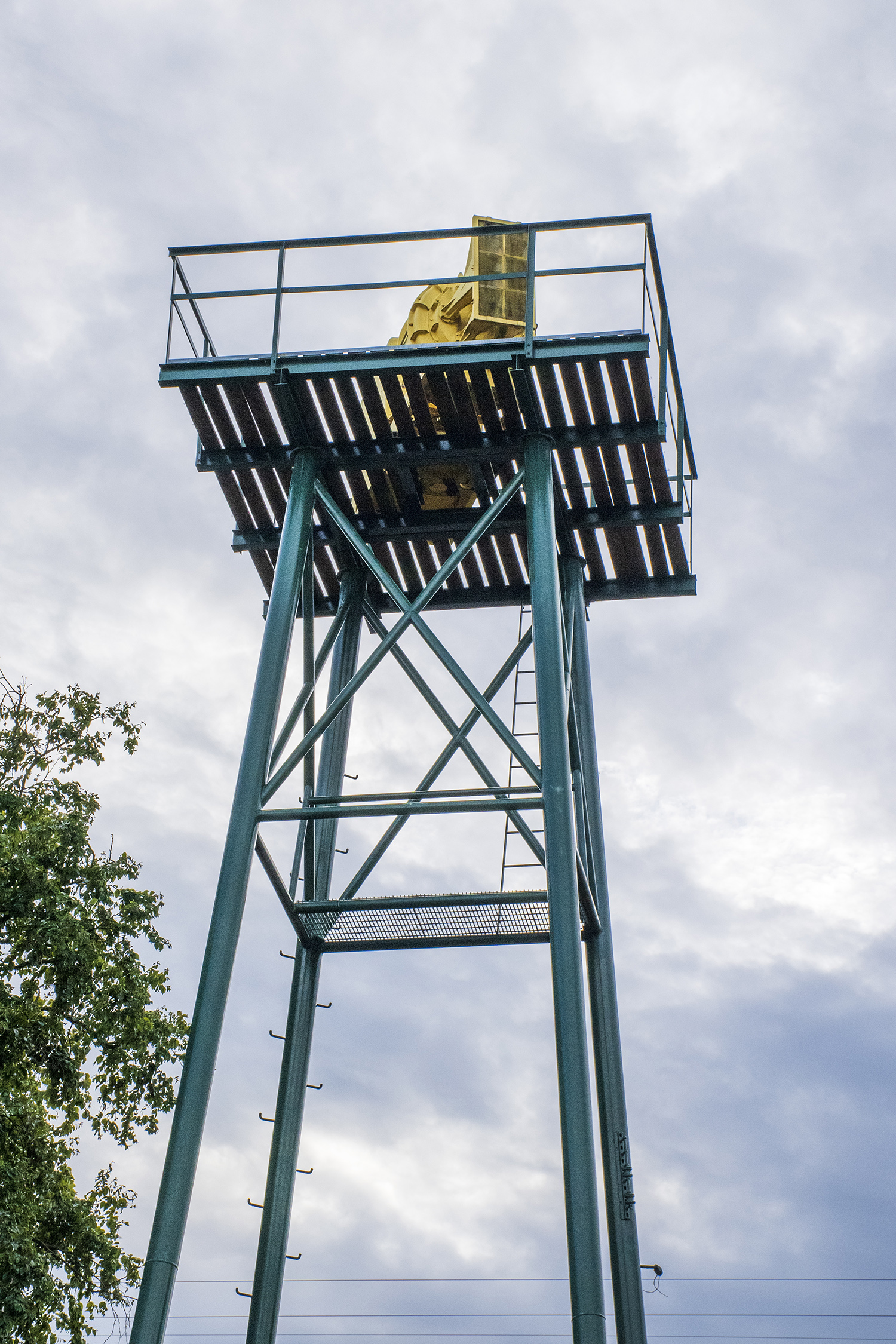 One of the country's few remaining air raid towers can be found in Seattle's Phinney Ridge neighborhood. Built in 1954 to alert residents of potential nuclear air threats, the Phinney Park Air Raid Tower featured the loudest siren ever built. The hazard yellow, Cold War relic stands tall above a small pocket park and across the street from Red Mill Burgers. But don't worry, the siren no longer works. (Image: Rachael Jones / Seattle Refined)