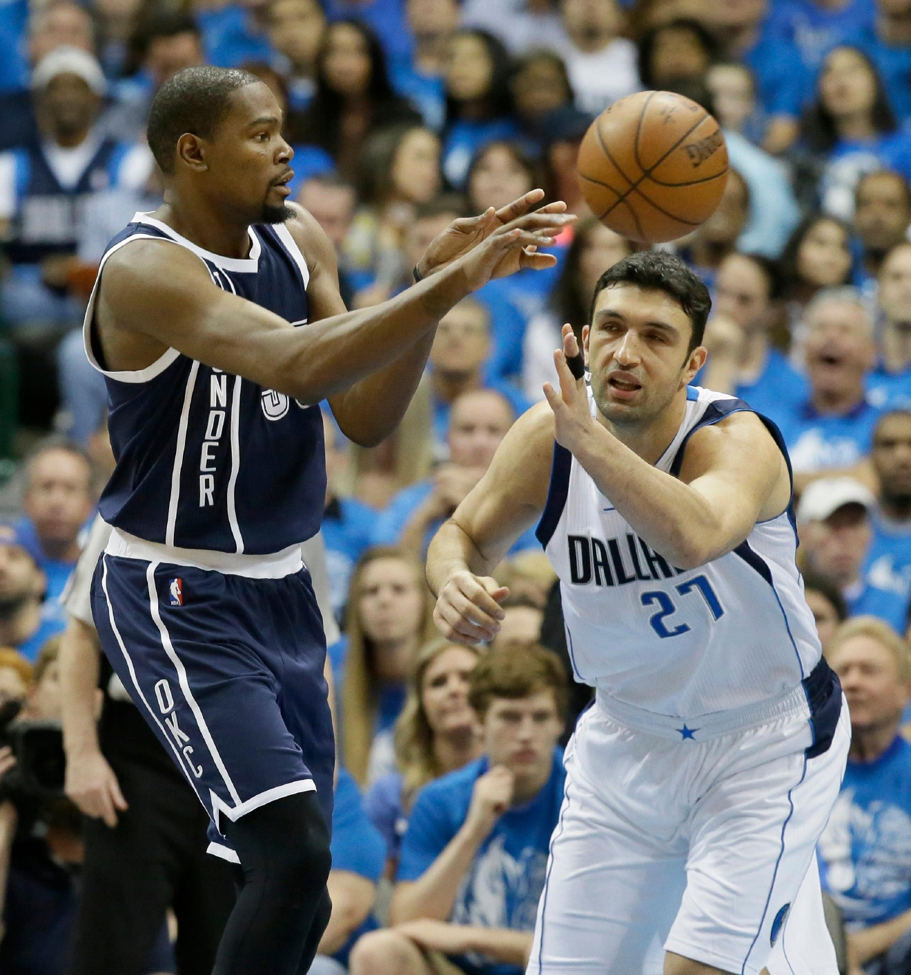 Oklahoma City Thunder forward Kevin Durant (35) passes the ball past Dallas Mavericks center Zaza Pachulia (27) during the first half in Game 3 of a first-round NBA basketball playoff series Thursday, April 21, 2016, in Dallas. (AP Photo/LM Otero)