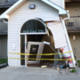 Car crashes into entrance of Arbor Apartments