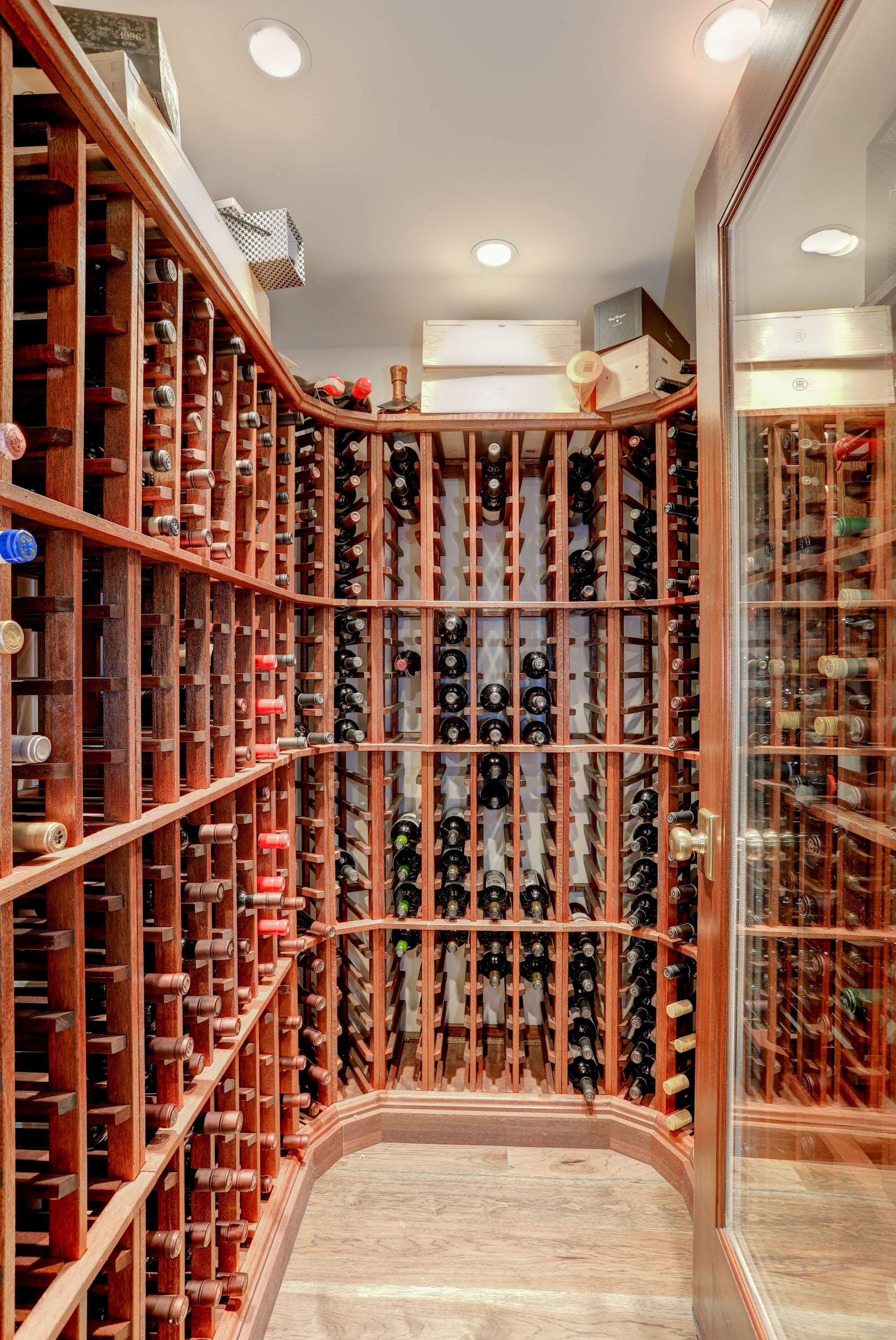 The finished basement includes a climate-controlled wine cellar that can hold up to 500 bottles. (Image: Courtesy HomeVisit)<p></p>