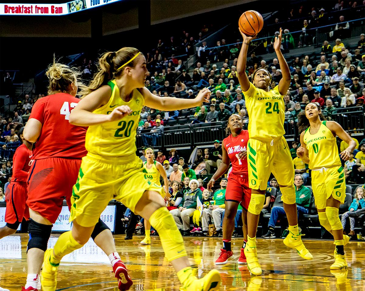 The Duck's Sabrina Ionescu (#20) passes to teammate Ruthy Hebard (#24) for the shot. The Duck's Sabrina Ionescu (#20) is introduced at the start of the game against the Ole Miss Rebels. The Oregon Ducks womens basketball team defeated the Ole Miss Rebels 90-46 on Sunday at Matthew Knight Arena. Sabrina Ionescu tied the NCAA record for triple-doubles, finishing the game with 21 points, 14 assists, and 11 rebounds. Ruthy Hebard added 16 points, Satou Sabally added 12, and both Lexi Bando and Maite Cazorla scored 10 each. The Ducks will next face off against Texas A&M on Thursday Dec. 21 and Hawaii on Friday Dec. 22 in Las Vegas for Duel in the Desert before the start of Pac-12 games. Photo by August Frank, Oregon News Lab