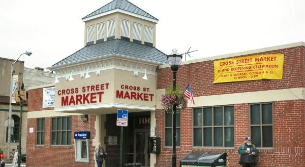 A stone's throw from the Inner Harbor, this historic district is the perfect place for an afternoon ramble. Check out the spot where Patriots climbed to celebrate Maryland's ratification of the US Constitution, swing by the infamous Cross Street Market for all kinds of good Baltimore eats and enjoy a signature cocktail at The Bookmakers. (Image: Courtesy Cross Street Market)