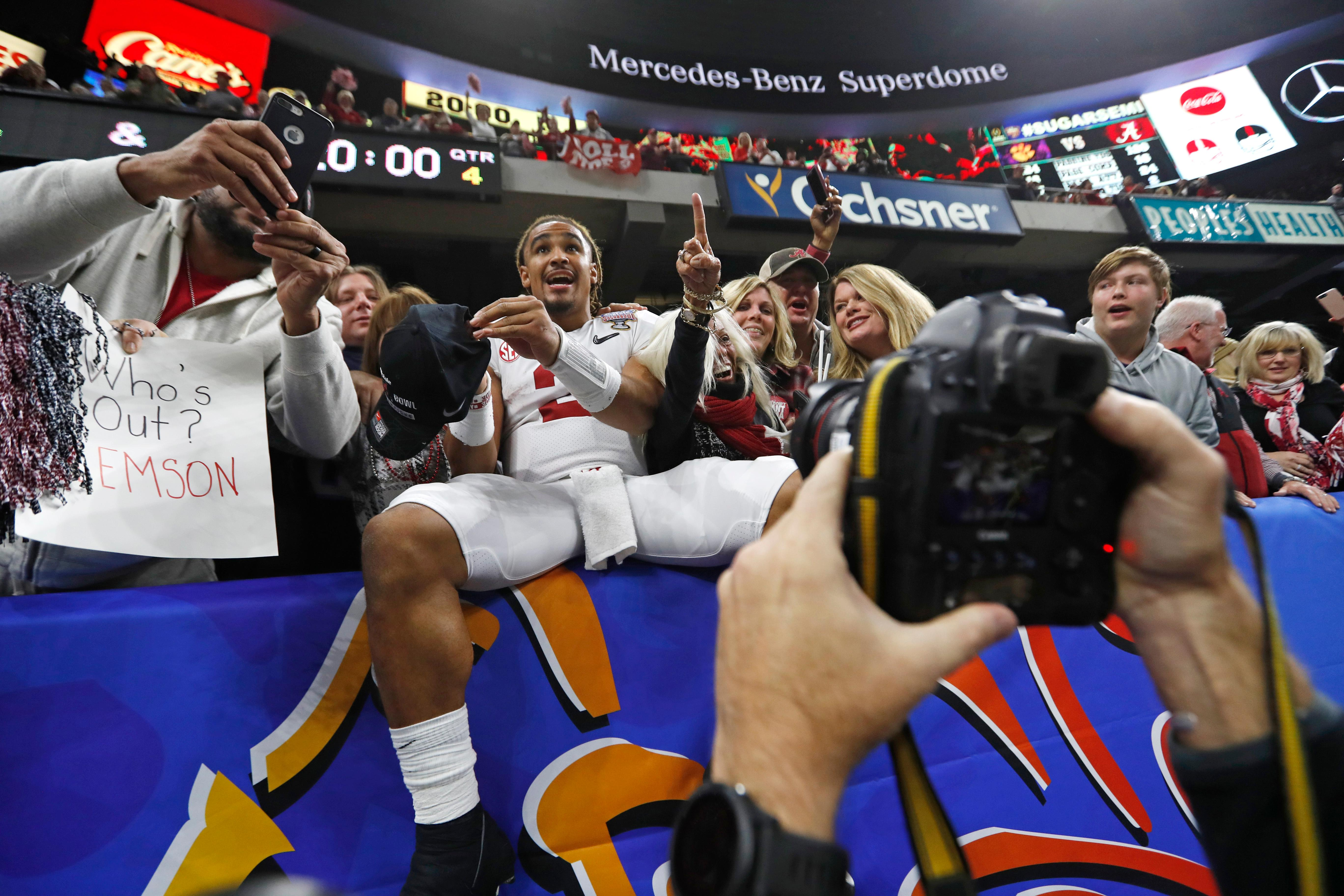 Alabama quarterback Jalen Hurts (2) celebrates by jumping into the stands defeating Clemson in the Sugar Bowl semi-final playoff game for the NCAA college football national championship, in New Orleans, Monday, Jan. 1, 2018. Alabama won 24-6 to advance to the national championship game. (AP Photo/Gerald Herbert)
