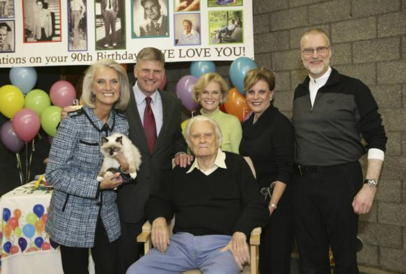 <p>Billy Graham on his 90th birthday,pictured with his children (Anne Graham Lotz, far left; Franklin Graham, second from left) (Photo credit: BGEA)</p>