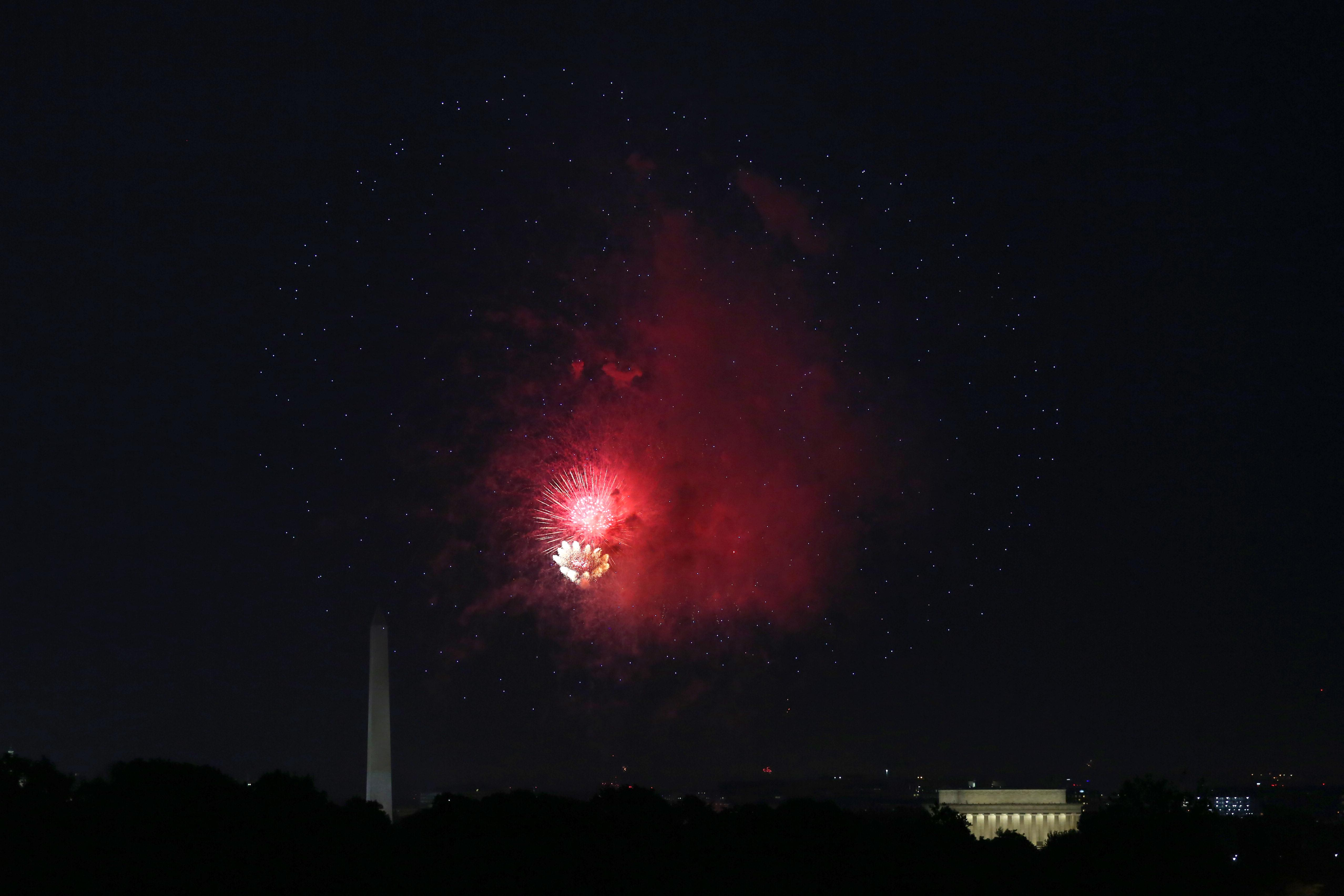 Almost miraculously, the weather cleared up for the first part of this year's 4th of July fireworks display over the National Mall. Here are our favorite pics from the festivities. (Amanda Andrade-Rhoades/DC Refined)