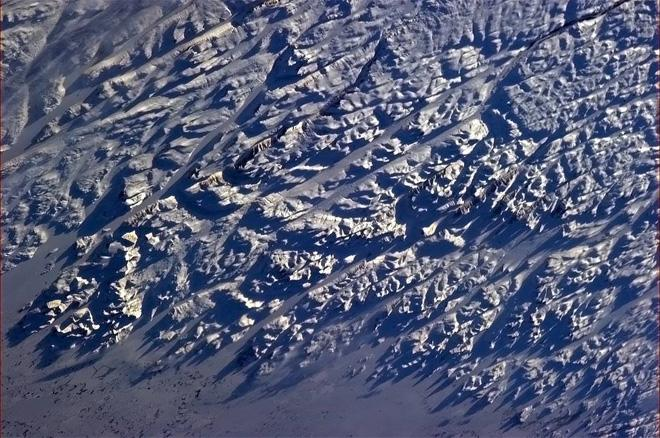 The starkly beautiful Labrador coast, stage-lit in the setting sun. (Photo & Caption: Col. Chris Hadfield, NASA)