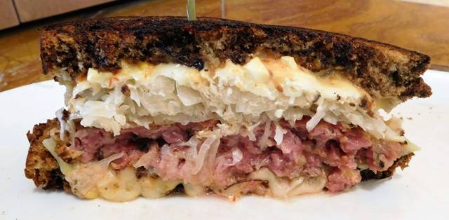 Kurobuta Pork Sausage Reuben.   John Howie Steak, located in downtown Bellevue, brings major sandwich game. Every day the steakhouse features a unique and new sandwich called they call #SandwichOfTheDay. Enjoy the gallery! These are just a few of the daily sandwiches that look absolutely mind-blowing. To see the current Sandwich of the Day, check out John Howie Steak's Facebook page. (Image courtesy of John Howie Steak)