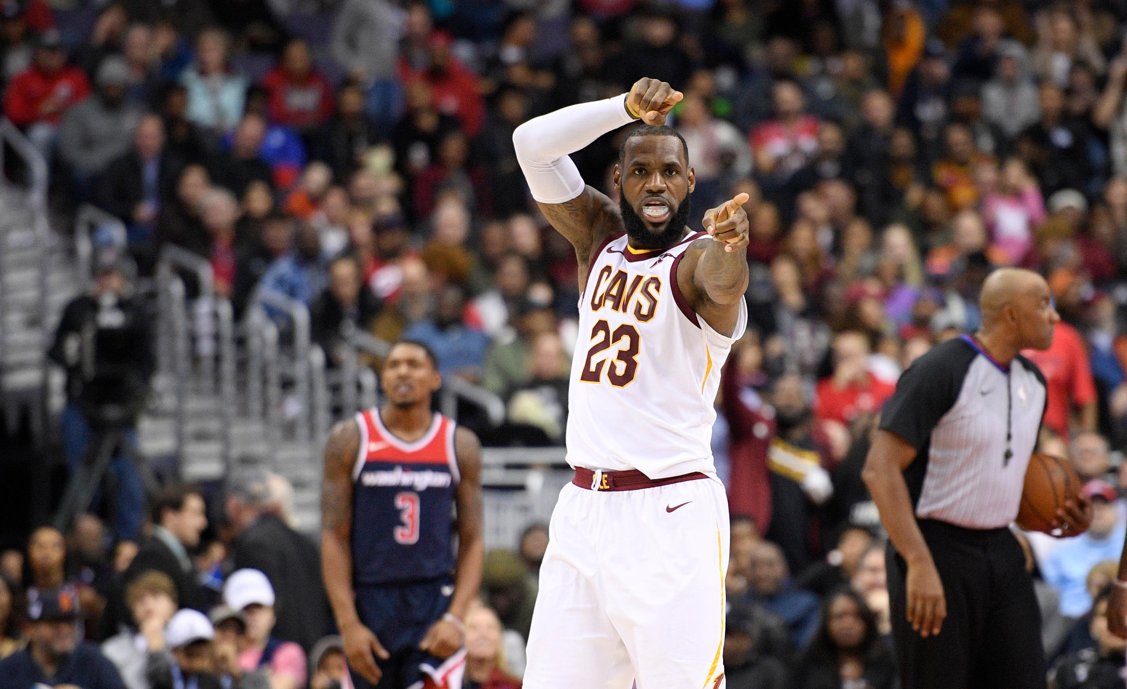 Cleveland Cavaliers forward LeBron James (23) gestures after he scored during the second half of an NBA basketball game as Washington Wizards guard Bradley Beal (3) looks on, Sunday, Dec. 17, 2017, in Washington. (AP Photo/Nick Wass)