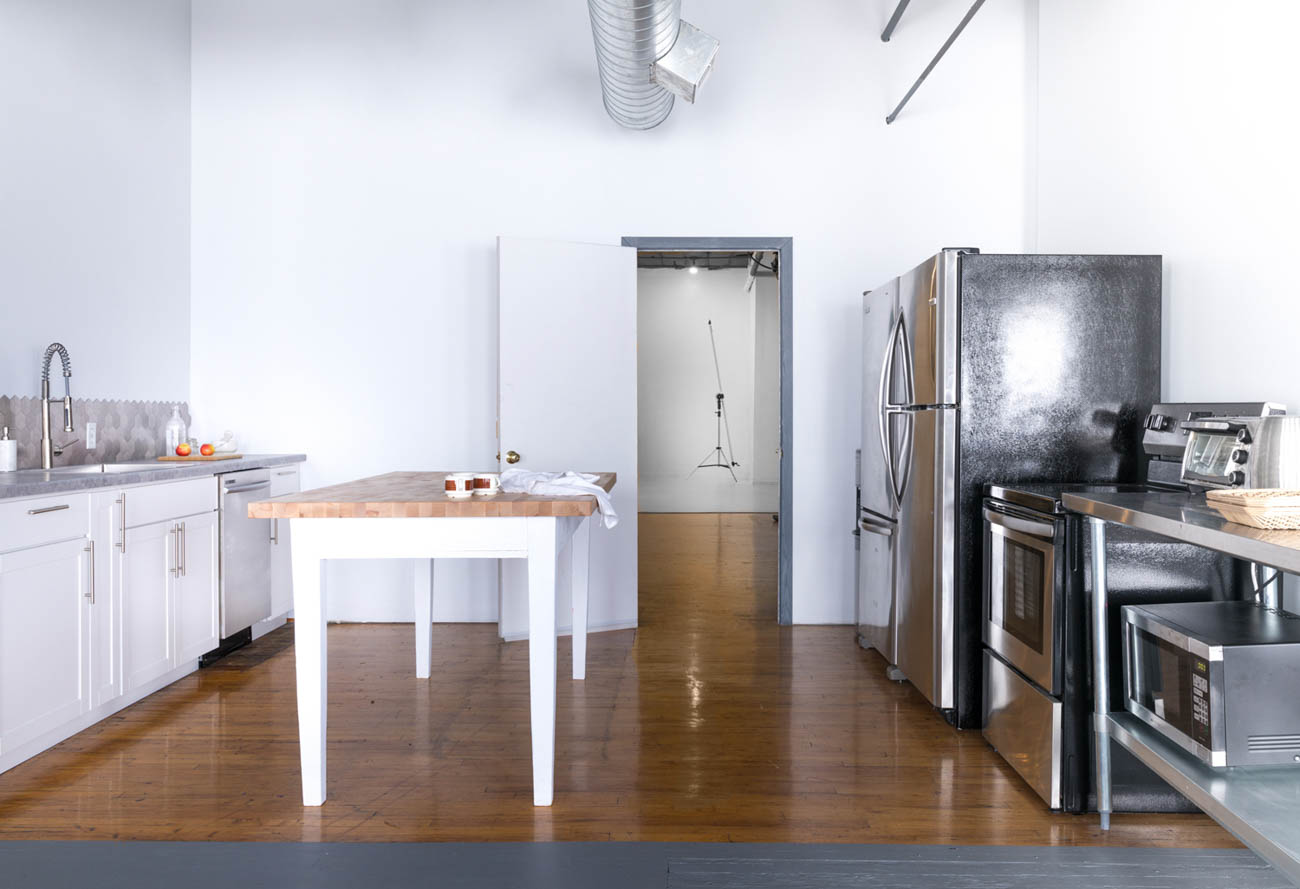 The studio addition sits within a space formerly occupied by an apartment adjoining their existing studio. After a two-month renovation that added a full kitchen with updated finishes, freshly painted walls, and modern furniture, Marlene and Jeremy's new space was photo-ready. / Image: Marlene Rounds // Published: 7.6.19