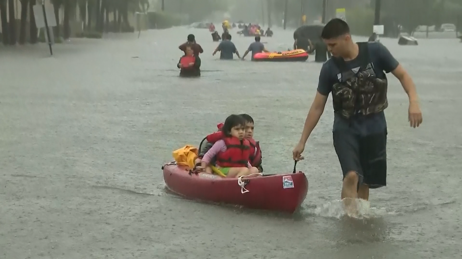 Young kids rescued in canoe  (KPRC / CNN)