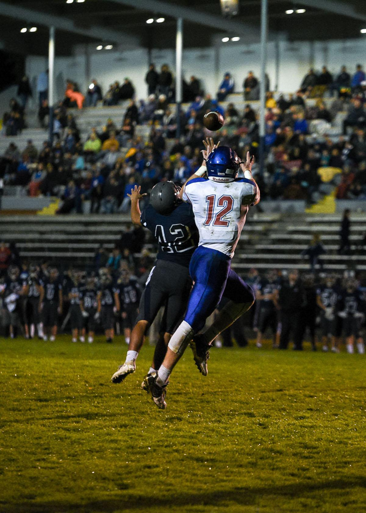 Churchill tight end Jax Arnold (#12) catches a pass for a touchdown during the Lancer's 56-7 victory over Springfield remaining 7-0 on the season. Photo by Jeff Dean, Oregon News Lab
