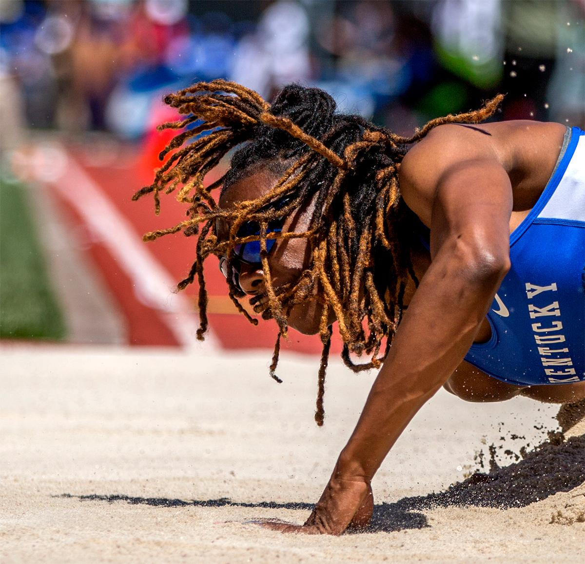 Kentucky's Shakeela Saunders hair cascades around her as she hits the sand in the long jump. Saunders finished fourth with a final distance of 6.89m. Photo by August Frank, Oregon News Lab