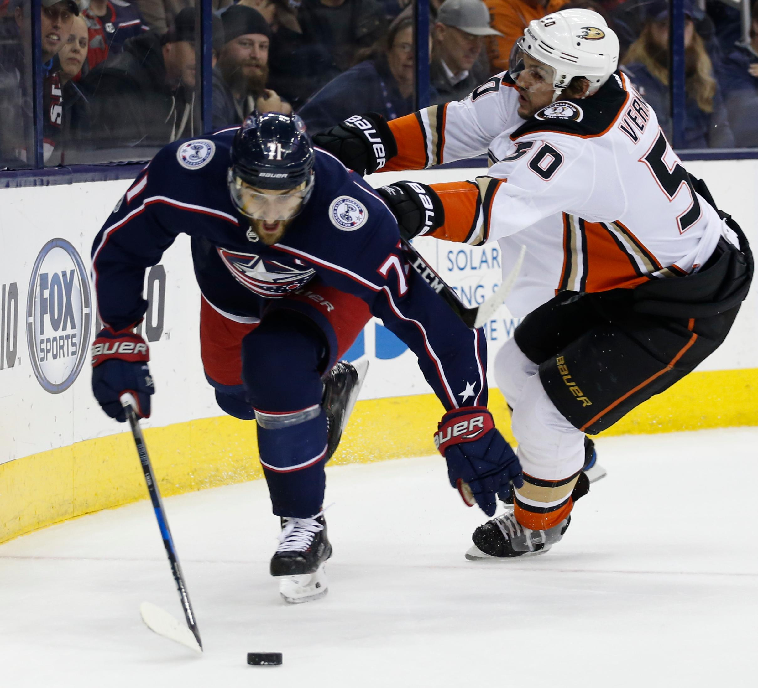 Anaheim Ducks' Antoine Vermette, right, checks Columbus Blue Jackets' Nick Foligno during the second period of an NHL hockey game Friday, Dec. 1, 2017, in Columbus, Ohio. (AP Photo/Jay LaPrete)