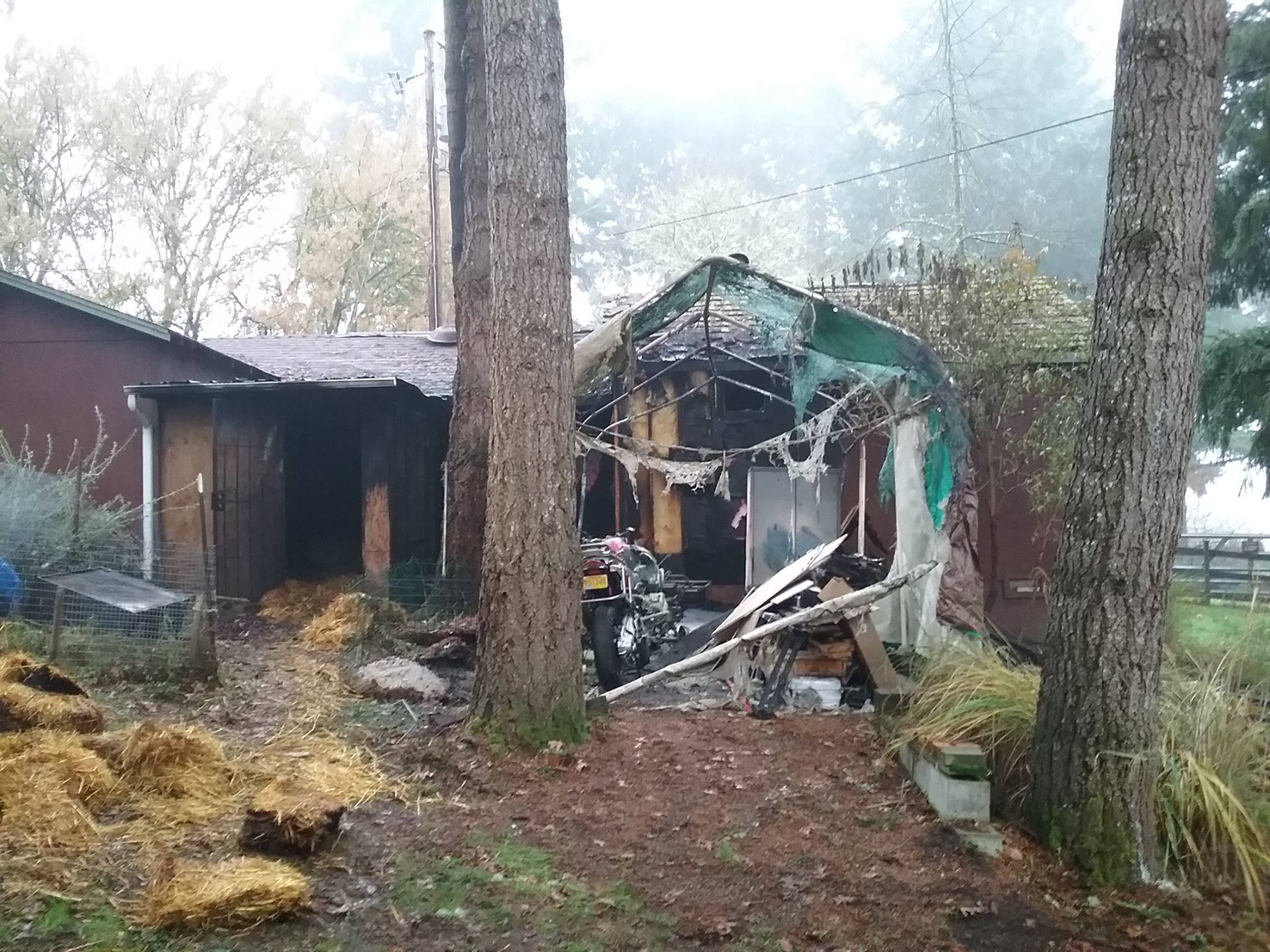 A fire next to an outbuilding at a residence on W. Old Melrose Road Tuesday evening brought a response from the Roseburg fire Department. (RFD)