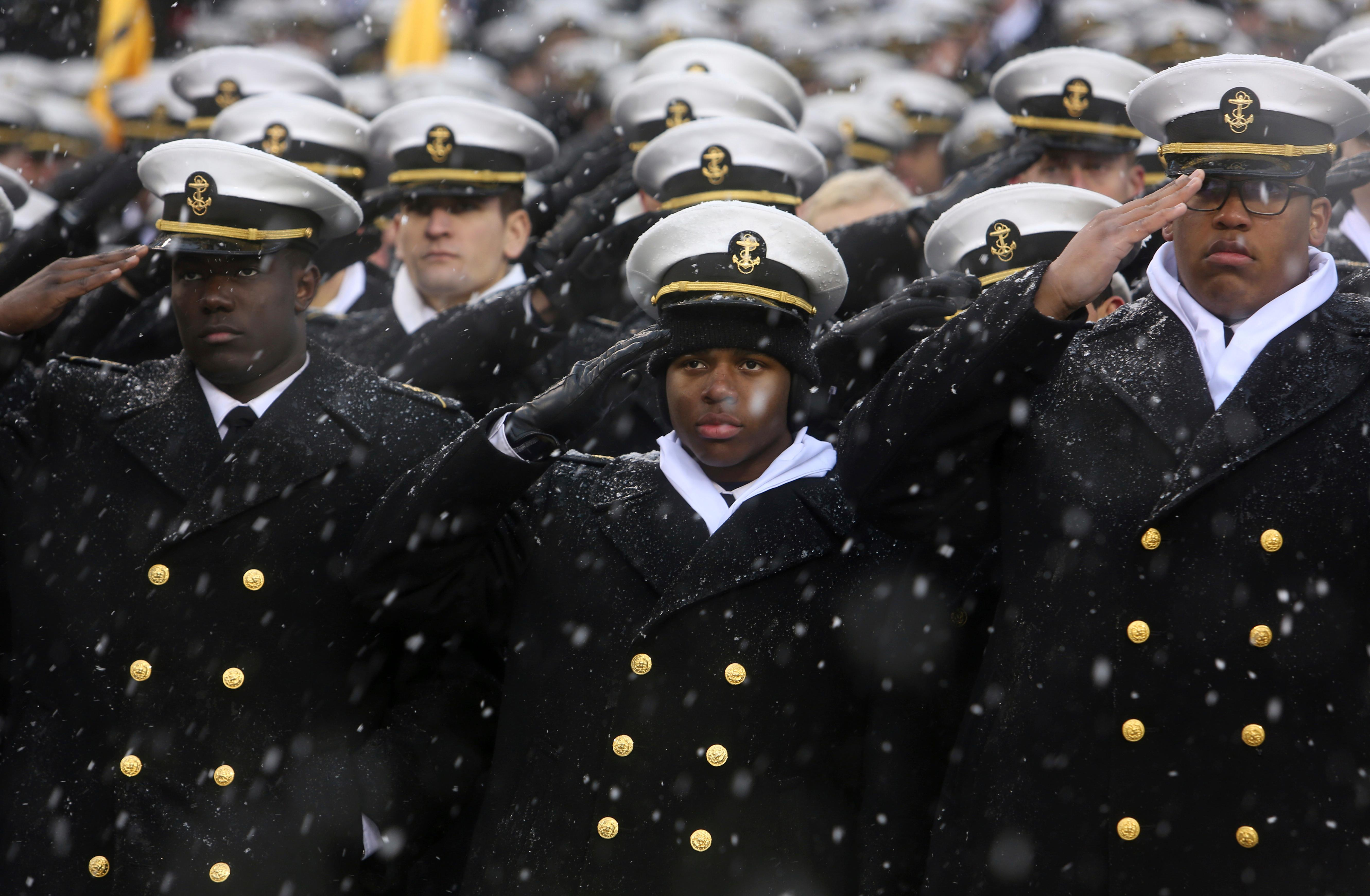 Navy Midshipmen salute during the national anthem just before the 118th meeting of the annual Army Navy football game, Saturday Dec. 9, 2017 in Philadelphia. (AP Photo/Jacqueline Larma)