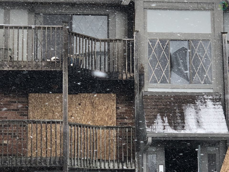 Many people were forced out of their apartment and out into the snow Sunday night due to a fire at Fox Glen Apartment complex in Saginaw Township. (WEYI/WSMH)<p></p>