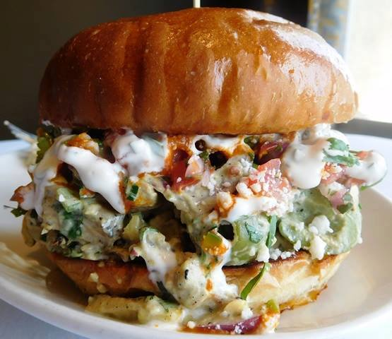 Southwestern Chicken Avocado Salad.   John Howie Steak, located in downtown Bellevue, brings major sandwich game. Every day the steakhouse features a unique and new sandwich called they call #SandwichOfTheDay. Enjoy the gallery! These are just a few of the daily sandwiches that look absolutely mind-blowing. To see the current Sandwich of the Day, check out John Howie Steak's Facebook page. (Image courtesy of John Howie Steak)