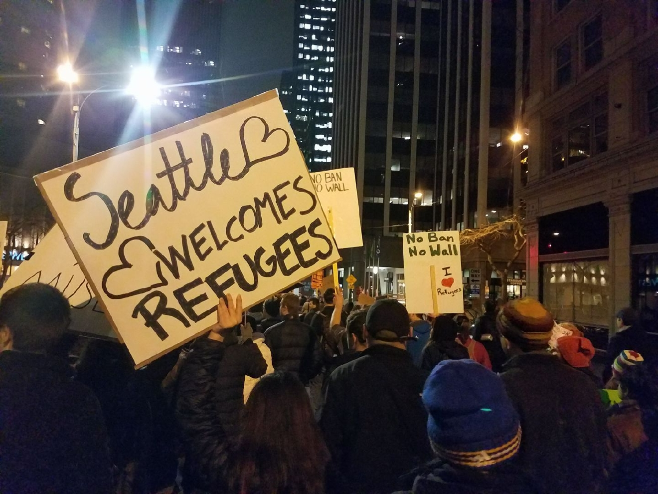 Thousands gathered in downtown Seattle Sunday night to speak out against President Donald Trump's refugee ban. (Photo: Holly Mitchell).