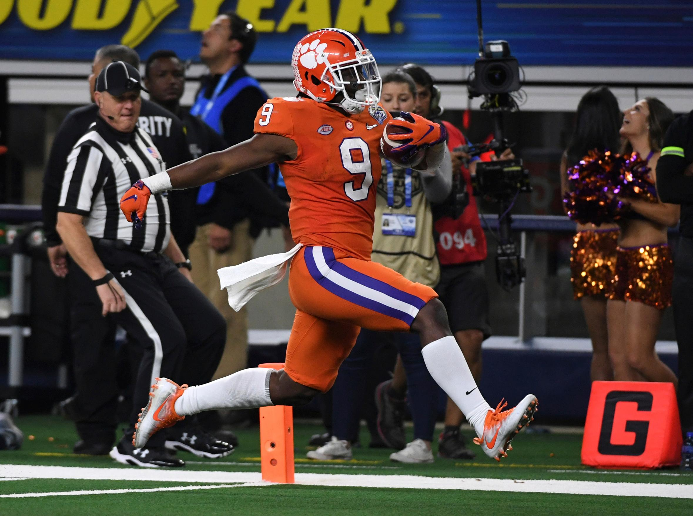 Clemson running back Travis Etienne (9) sprints into the end zone for a touchdown in the second half of the NCAA Cotton Bowl semi-final playoff football game against Notre Dame on Saturday, Dec. 29, 2018, in Arlington, Texas. (AP Photo/Jeffrey McWhorter)