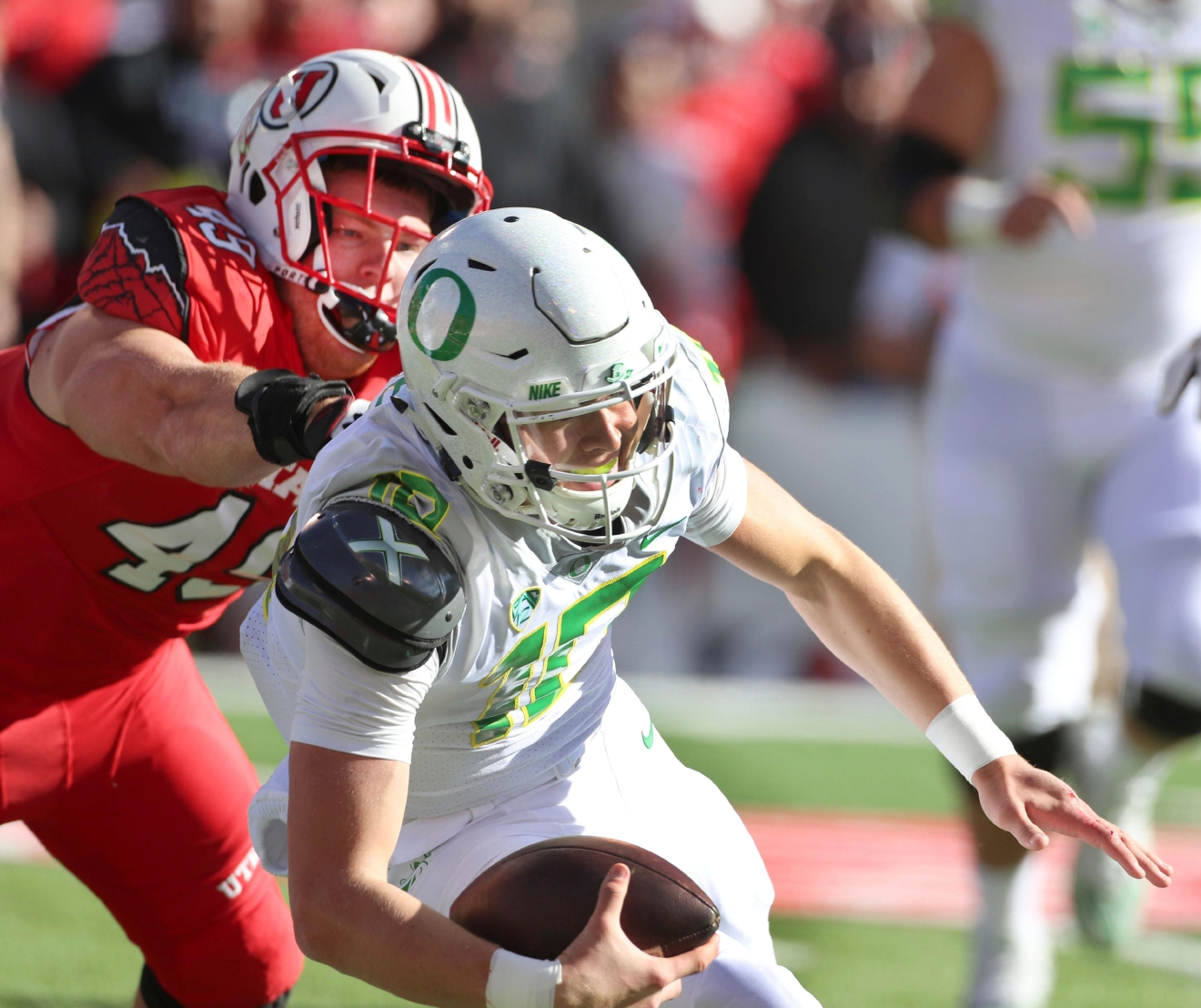 Utah defensive end Hunter Dimick (49), sacks Oregon quarterback Justin Herbert (10) in the first half of an NCAA college football game, Saturday, Nov. 19, 2016, in Salt Lake City. (AP Photo/George Frey)