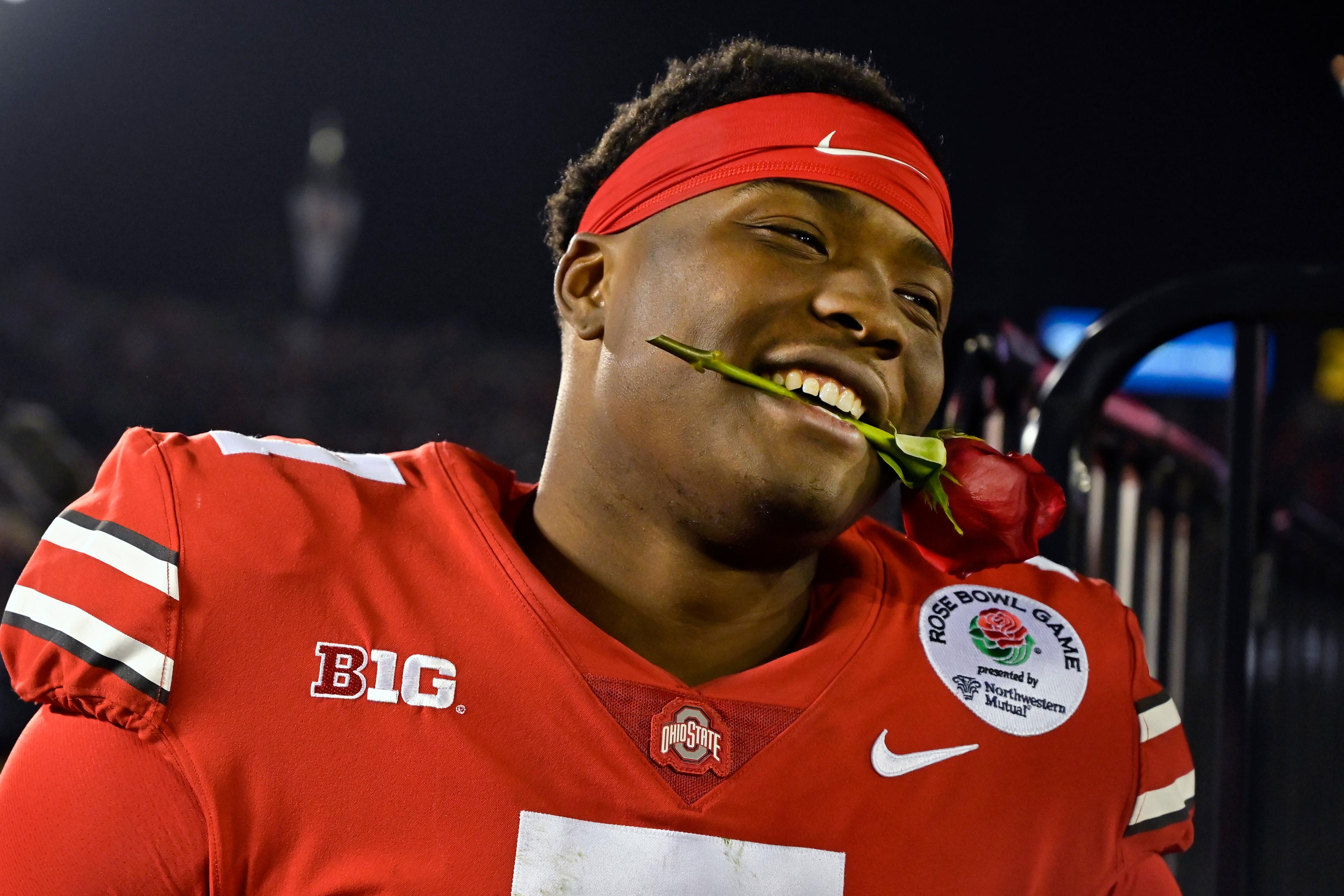 Ohio State quarterback Dwayne Haskins smiles, with a rose between his teeth, after Ohio State defeated Washington 28-23 in the Rose Bowl NCAA college football game Tuesday, Jan. 1, 2019, in Pasadena, Calif. (AP Photo/Mark J. Terrill)
