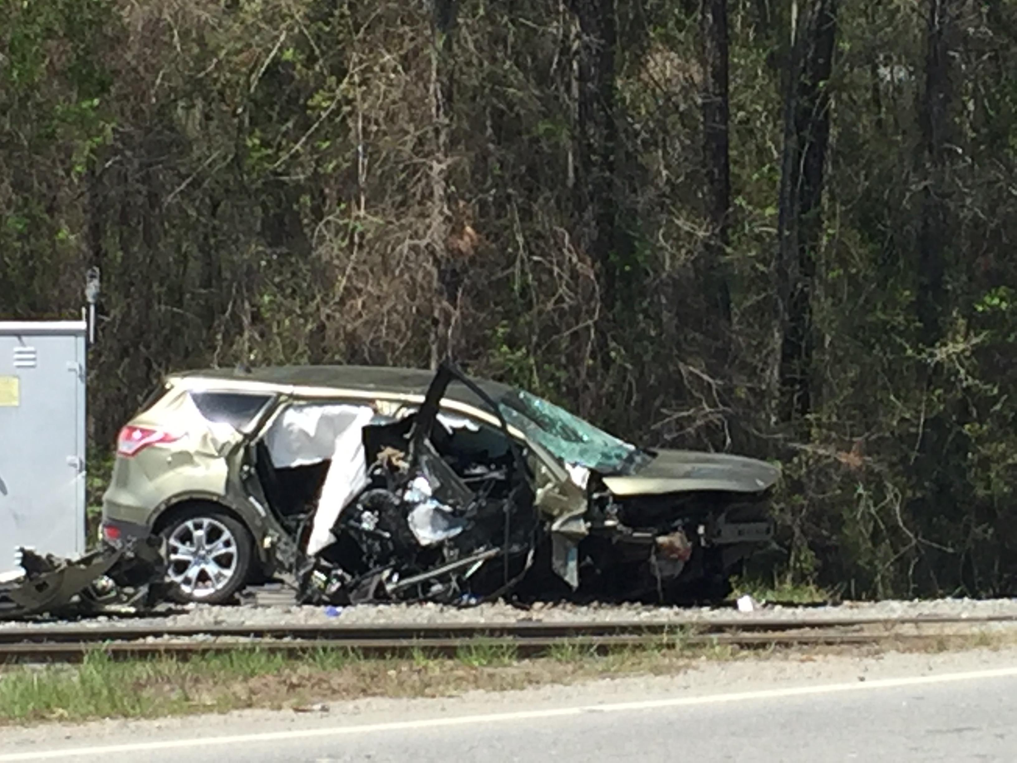A car crashed near a train track on Highway 49 in Jones County Tuesday afternoon/David Domingue (WGXA)