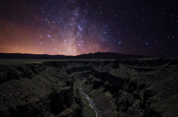"IMAGE: IG user @mexisalvamericano / POST: ""Worlds Collide"" Shot last year from the Taos Gorge Bridge on a beautifully moonlit night."