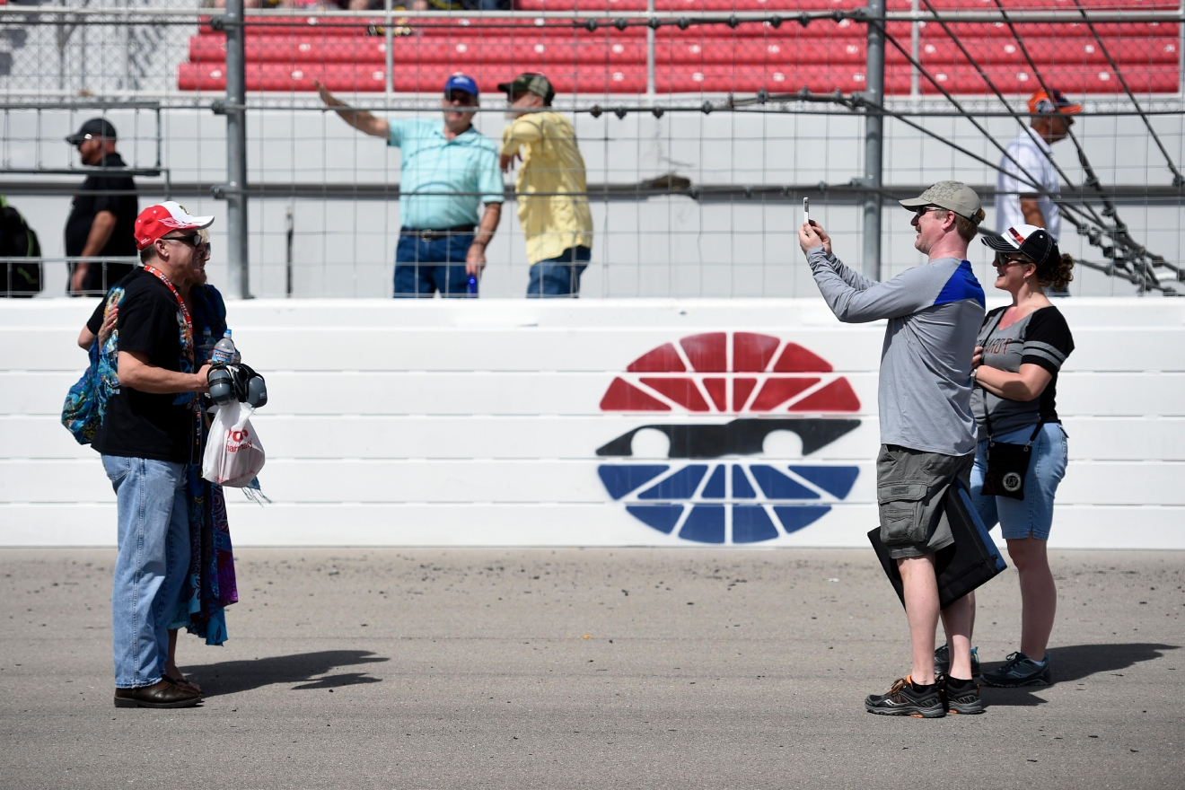 Fans take a quick photo on the track before the Monster Energy NASCAR Cup Series Kobalt 400 Sunday, March 12, 2017, at the Las Vegas Motor Speedway. (Sam Morris/Las Vegas News Bureau)