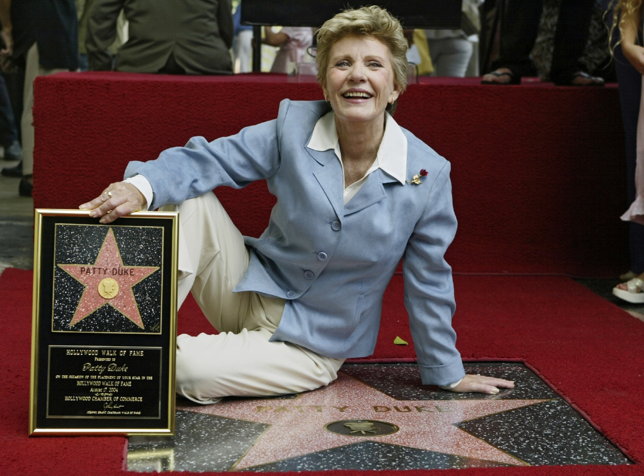 FILE - In this Aug. 17, 2004 file photo, actress Patty Duke is honored with a star on the Hollywood Walk of Fame in Los Angeles.Duke, who won an Oscar as a child at the start of an acting career that continued through her adulthood, died Tuesday, March 29, 2016, of sepsis from a ruptured intestine. She was 69. (AP Photo/Damian Dovarganes, File)