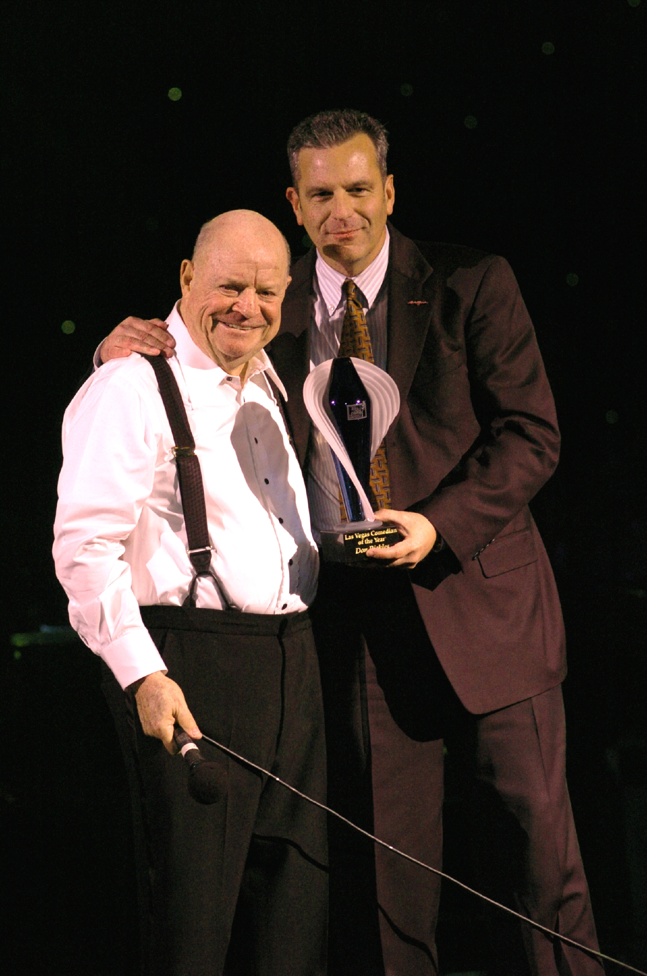 Don Rickles receives Las Vegas Comedian of the Year award from Rob Powers at the Stardust on Oct. 14, 2004. [Las Vegas News Bureau file photo]