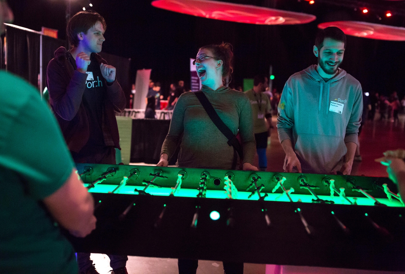 Hayley Johnson of Porch.com competes in a game of extra-long foosball at the 6th annual Geekwire Bash at the CenturyLink Event Center. (Sy Bean / Seattle Refined)