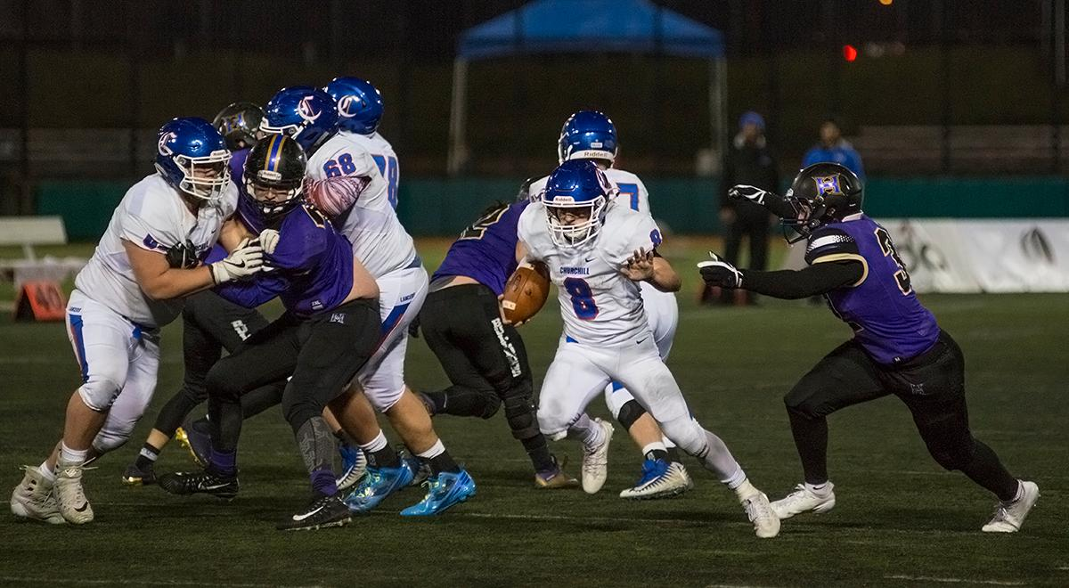 Churchill Lancers running back Dalton McDaniel (#8) dodges the Hermiston Bulldogs defense.                  The Hermiston Bulldogs defeated the Churchill Lancers 38-35 for the 5A state title Saturday evening at Hillsboro Stadium. Photo by Abigail Winn, Oregon News Lab