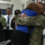 Deployed soldier surprises sister after year apart