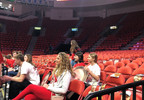 A limited number of Arcadia High School fans watch warmups for the girls state high school basketball tournament March 12, 2020, at the Resch Center in Ashwaubenon. (WLUK/Kia Murray)