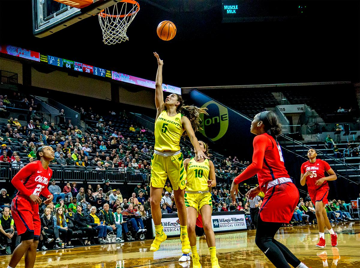 The Duck's Maite Cazorla (#5) runs up for a shot. The Duck's Sabrina Ionescu (#20) is introduced at the start of the game against the Ole Miss Rebels. The Oregon Ducks women?s basketball team defeated the Ole Miss Rebels 90-46 on Sunday at Matthew Knight Arena. Sabrina Ionescu tied the NCAA record for triple-doubles, finishing the game with 21 points, 14 assists, and 11 rebounds. Ruthy Hebard added 16 points, Satou Sabally added 12, and both Lexi Bando and Maite Cazorla scored 10 each. The Duck?s will next face off against Texas A&M on Thursday Dec. 21 and Hawaii on Friday Dec. 22 in Las Vegas for Duel in the Desert before the start of Pac-12 games. Photo by August Frank, Oregon News Lab