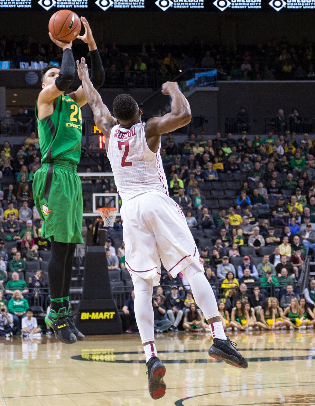 Oregon Ducks' Dillon Brooks (#24) attempts a three point shot while being defended by Washington State Cougars' Ike Iroegbu (#2). The Ducks beat the Cougars 76-62. Kianna Cabuco, Oregon News Lab