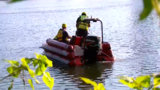 Crews pull stolen car from Arkansas River