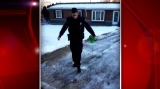 Menasha Police Officer salts injured man's driveway after icy weather