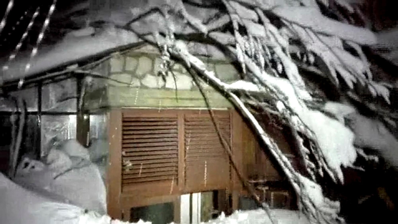 This photo taken from a video released by rescuers shows a window of the hotel hit by an avalanche in Farindola, Italy, early Thursday, Jan. 19, 2017. A hotel in the mountainous region hit again by quakes has been covered by an avalanche, with reports of dead. Italian media say the avalanche covered the three-story hotel in the central region of Abruzzo, on Wednesday evening. (Italian Finance Police via AP)