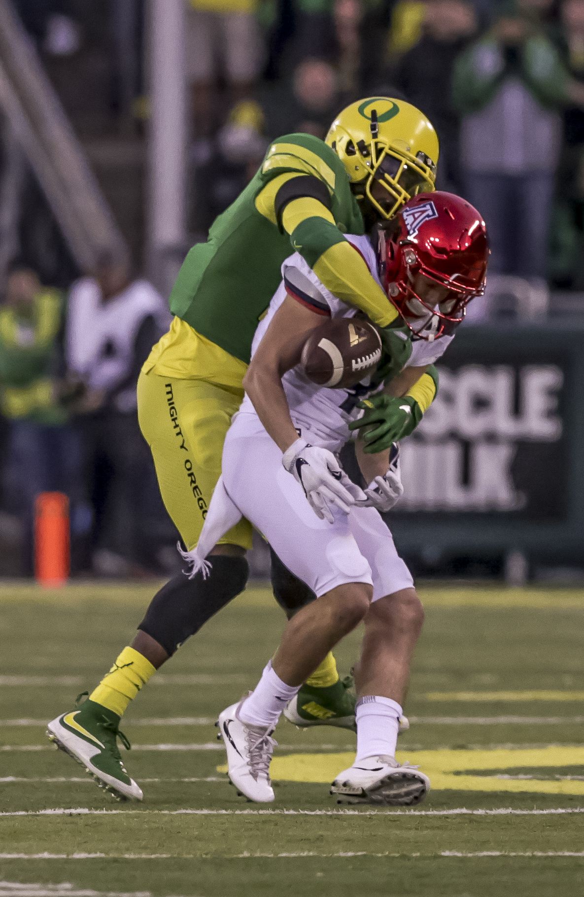 Oregon safety Tyree Robinson (#2) breaks up a pass intended for Arizona wide receiver Tony Ellison (#9). The Oregon Ducks lead the Arizona Wildcats 28 to 21 at the end of the first half at Autzen Stadium on Saturday, November 18, 2017. Photo by Ben Lonergan, Oregon News Lab
