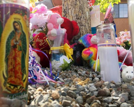 A memorial for a 10-year-old girl who police said was sexually assaulted, strangled then dismembered is seen at an Albuquerque, N.M., apartment building Thursday, Aug. 25, 2016. (AP Photo/Russell Contreras)